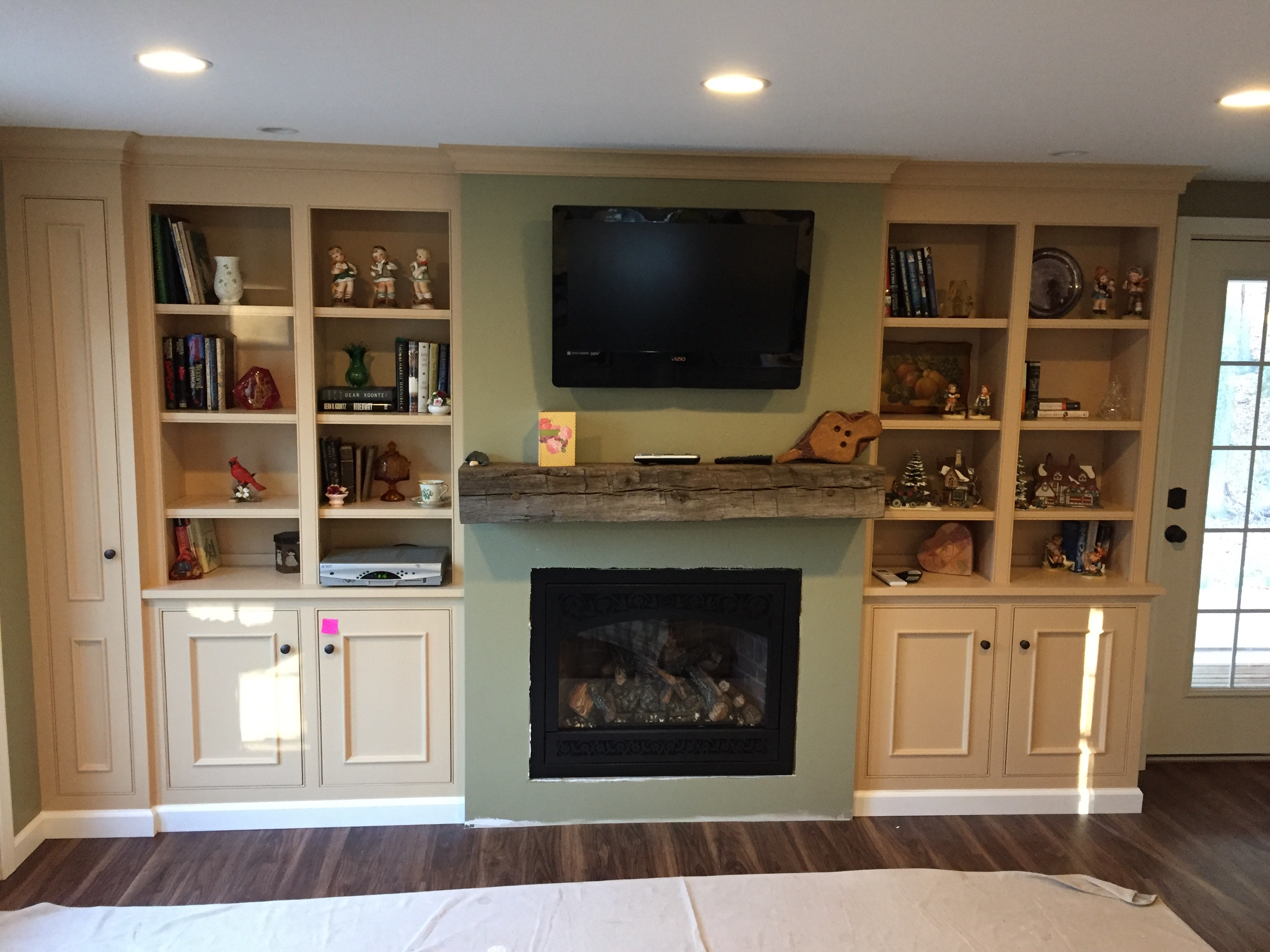 Built In Cabinetry With Reclaimed Beam Mantel
