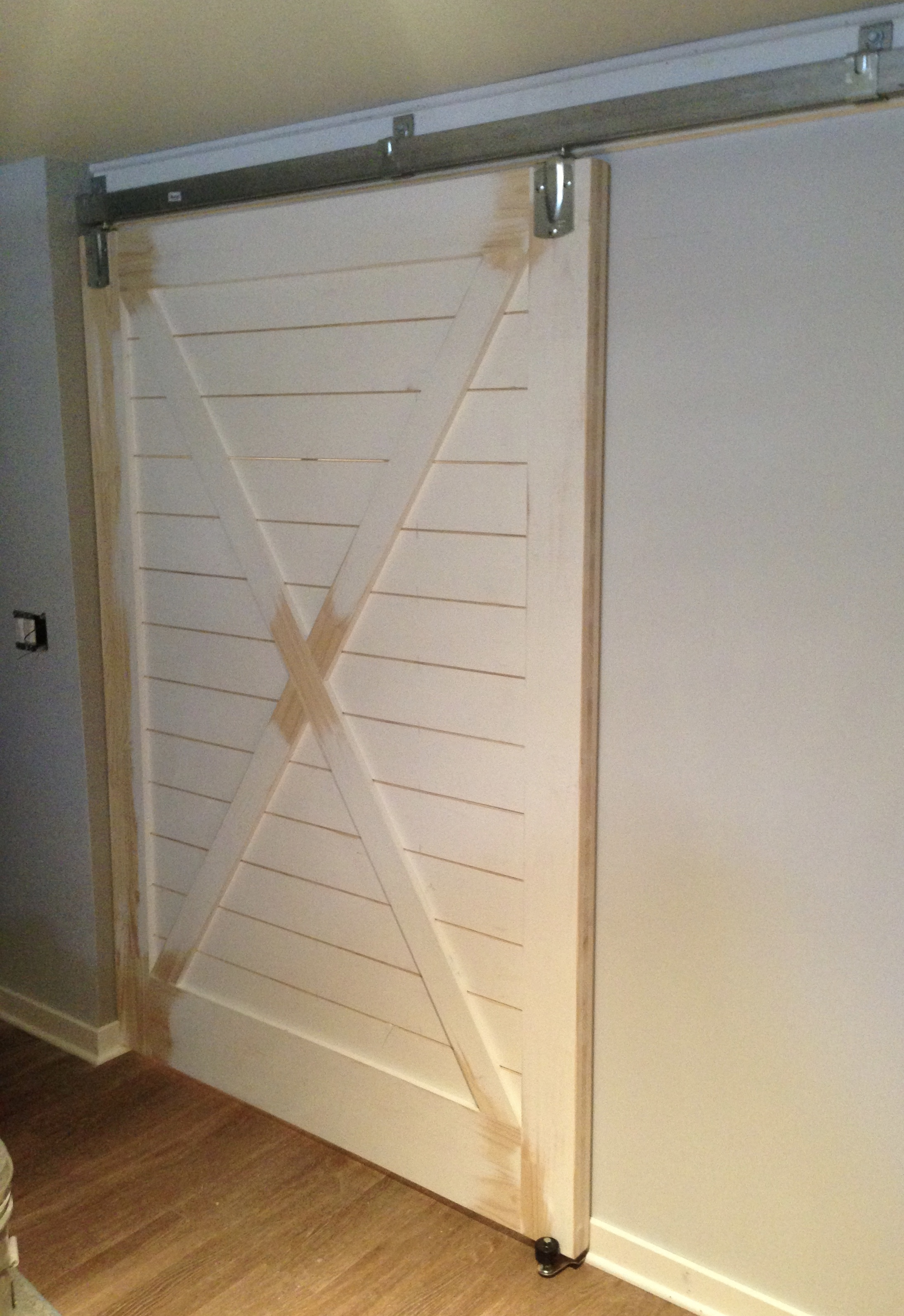 Sliding barn door for basement play room