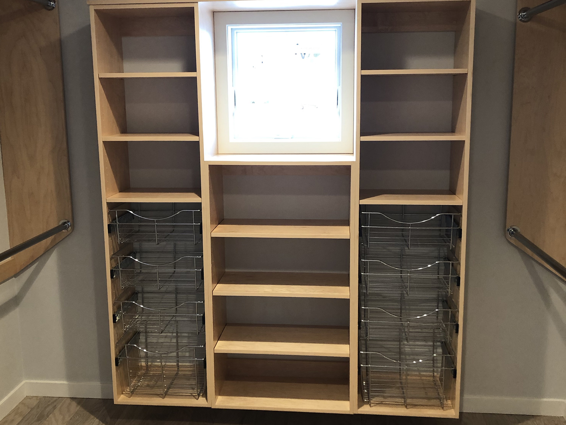 Master bedroom closet system with wire baskets