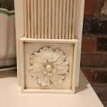 Flower rosette pained with a glaze finish.